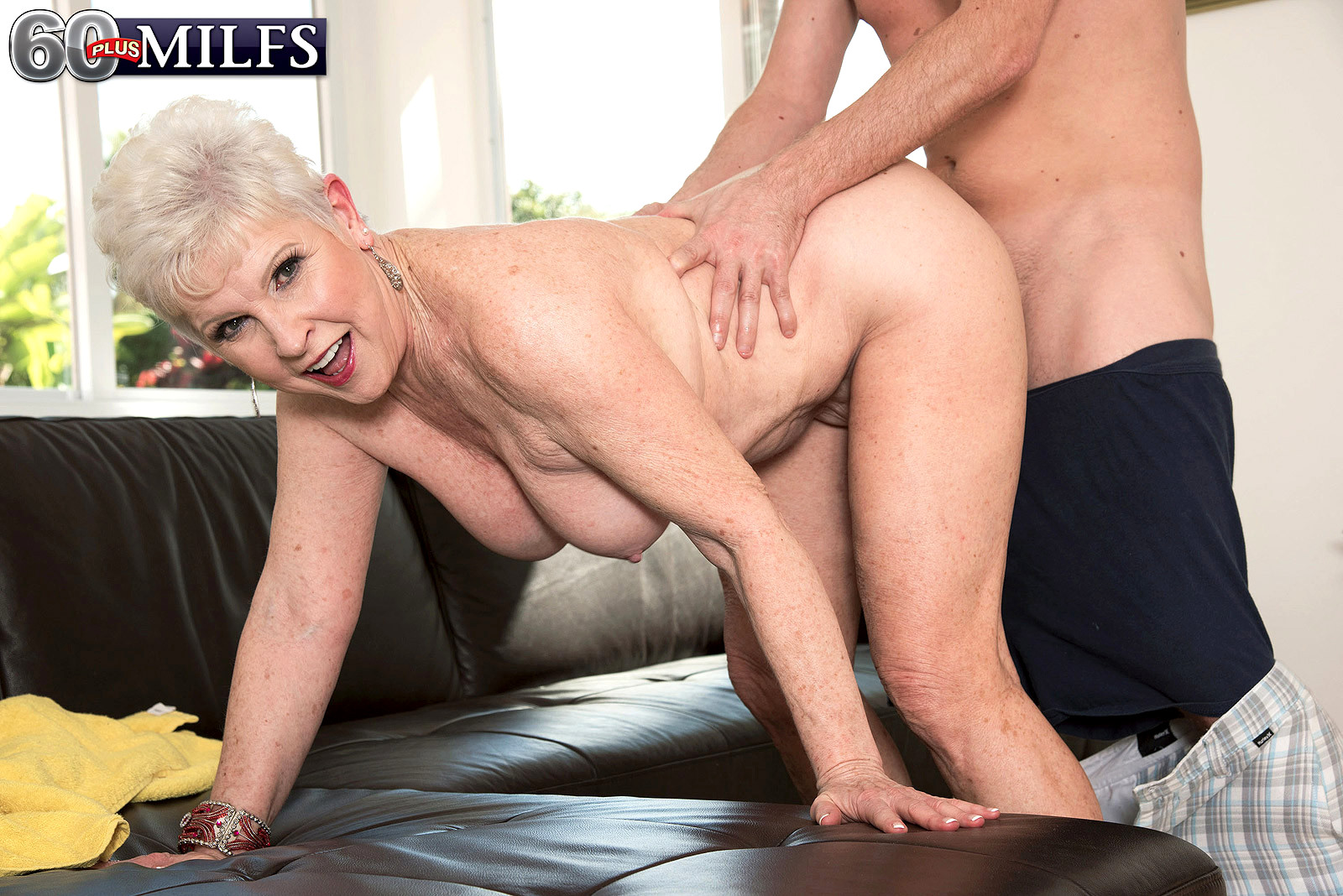 Hot grandma is fucking with a friend of her son