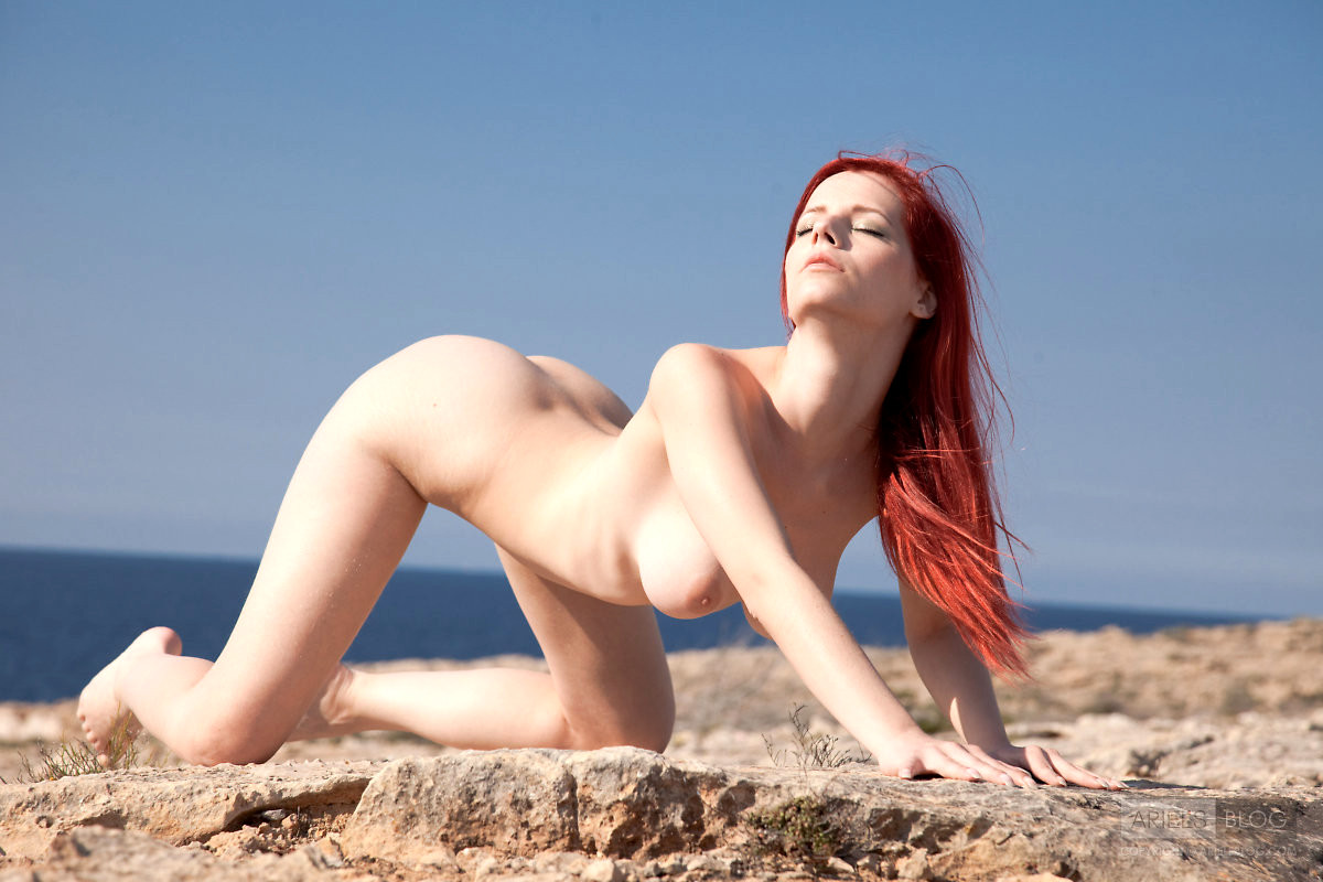 Perfect naked red head