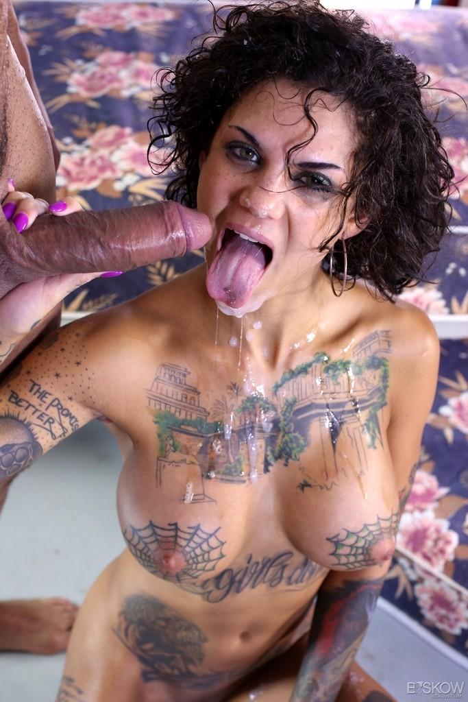 Tattooed brunette rides cock