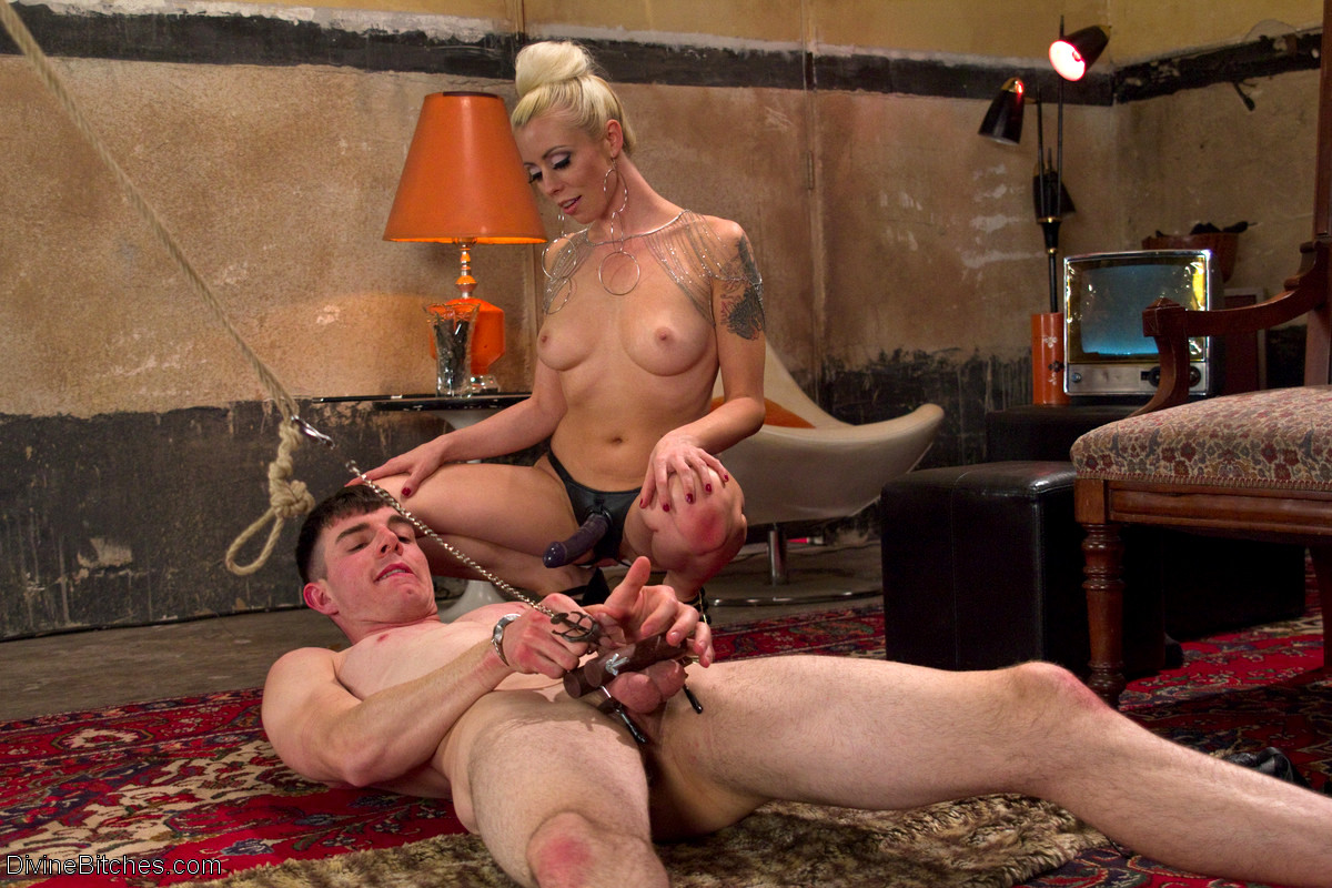Slave guy gets spanked and fucked by sexy blonde