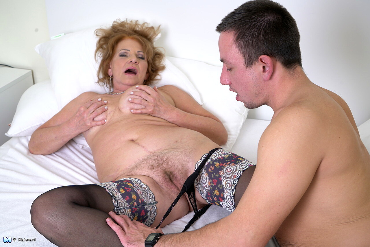 Mature british lady in stockings fucks younger guy