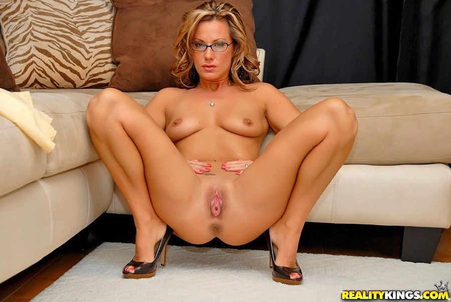 Brianna frost on a table showing off her pussy in high heels