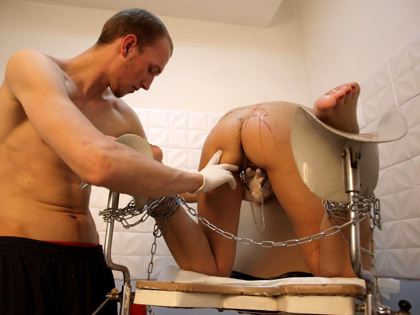 Forced medical examination with semen sample extraction