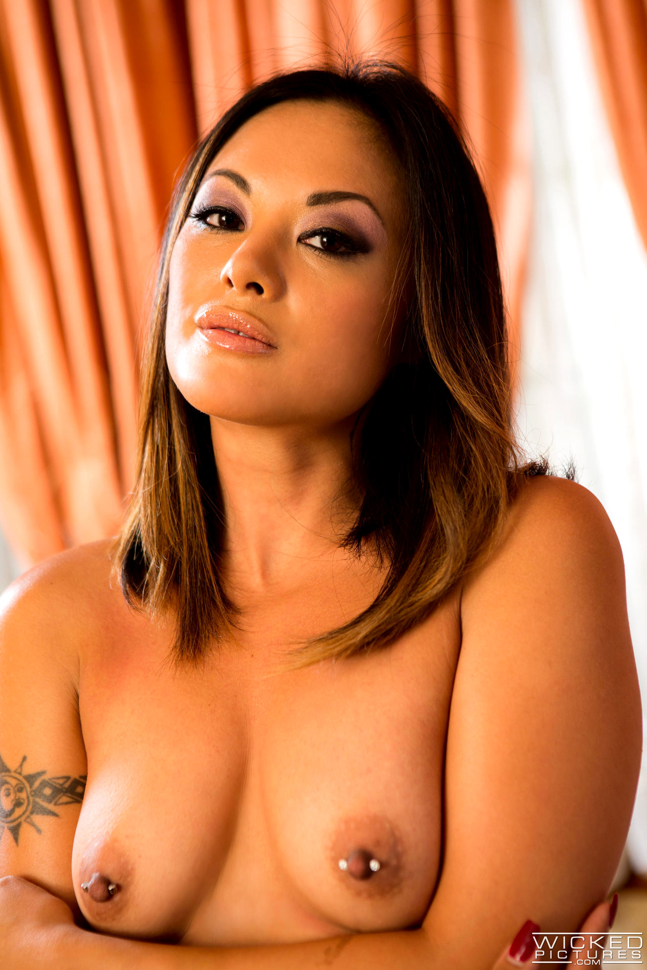 Kaylani lei serving forbidden fruits on a naked body